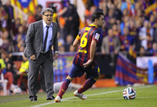 Barcelona's coach Gerardo Martino of;;owe the action from the side line during the final of the Copa del Rey between FC Barcelona and Real Madrid at the Mestalla stadium in Valencia, Spain, Wednes