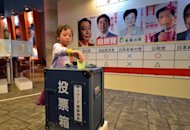 A little girl casts a vote in a straw poll at the Kidzania career theme park in Tokyo. Japan's young people, alienated and outnumbered by a greying population, will barely bother to vote in weekend polls after a campaign that excluded social media and made little effort to engage them