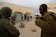 Malian soldiers enter a house which was held by Islamists, after Malian and French soldiers entered the historic city of Timbuktu, on January 28, 2013