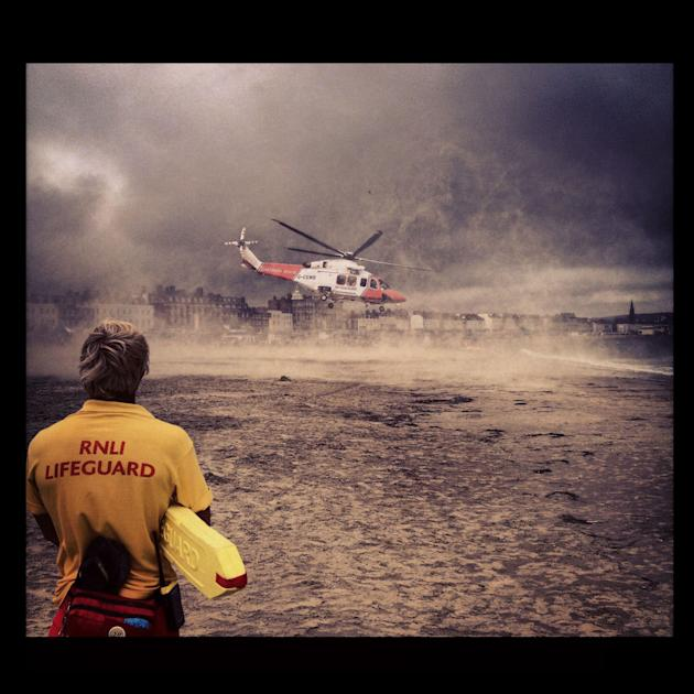 Third place photo 'A Helping Hand' was taken by Jake Clifford during a major first aid incident on Weymouth beach. Jake and the other lifeguards had cleared the landing site for a rescue helic