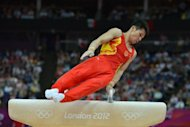 China's gymnast Zhang Chenglong competes on the pommel horse during the men's team final of the artistic gymnastics event of the London Olympic Games at the 02 North Greenwich Arena in London. China won gold