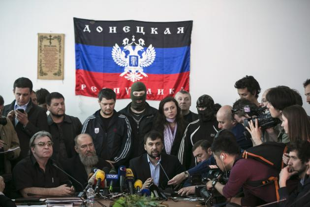 The head of pro-Russian separatists government Denis Pushilin speaks during news conference in regional government building in Donetsk