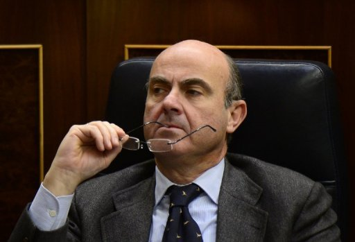 Spain's Economy Minister Luis de Guindos attends parliament in Madrid on December 20, 2012. Spain on Wednesday ruled out any Irish-style bailout for the recession-hit, jobs-starved economy, but said it was still undecided about seeking intervention by the European Central Bank to bring down its debt financing costs.