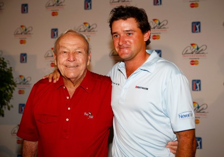 Arnold Palmer and his grandson Sam Saunders. (Getty Images)