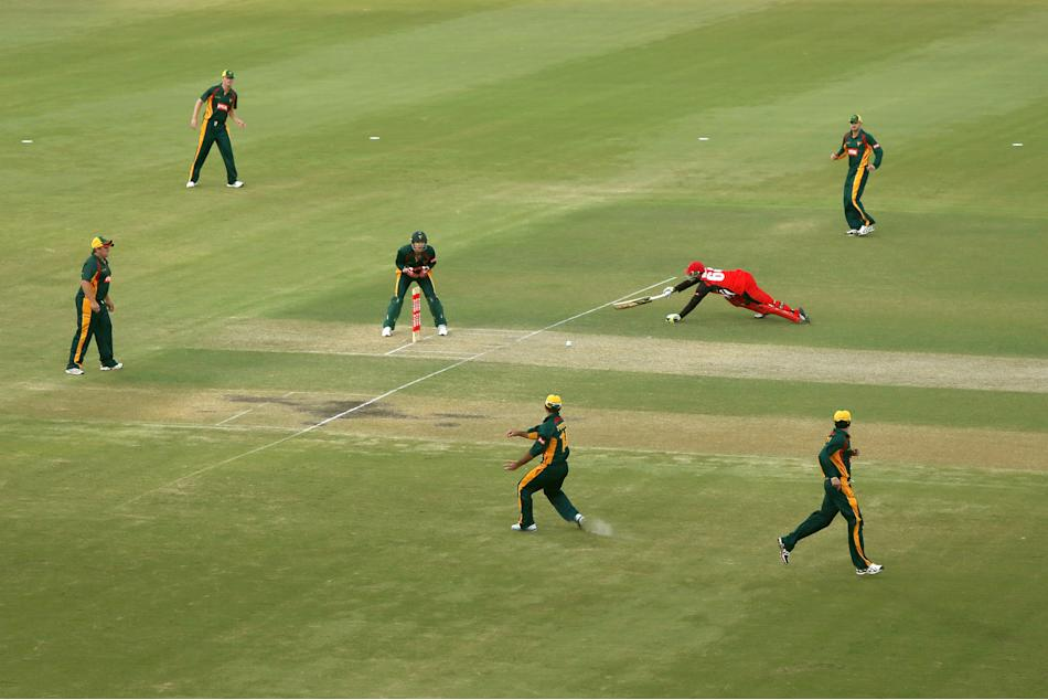 ADELAIDE, AUSTRALIA - OCTOBER 14: Phillip Hughes of the Redbacks makes his ground in time not to be run out during the Ryobi one day cup match between the South Australian Redbacks and the Tasmanian T