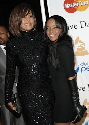"FILE - In this Feb. 12, 2011 file photo, singer Whitney Houston, left, and her daughter Bobbi Kristina arrive at the Pre-Grammy Gala & Salute to Industry Icons with Clive Davis honoring David Geffen in Beverly Hills, Calif. Bobbi Kristina Brown has been spotted wearing a sparkly bauble on her ring finger, but she's not planning on getting married anytime soon. A rep for Brown's mother, the late Whitney Houston, says the 19-year-old is ""simply wearing her mother's ring"" and that she's not engaged. (AP Photo/Dan Steinberg, file)"