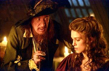 Geoffrey Rush and Keira Knightley of Walt Disney's Pirates Of The Caribbean: The Curse of the Black Pearl
