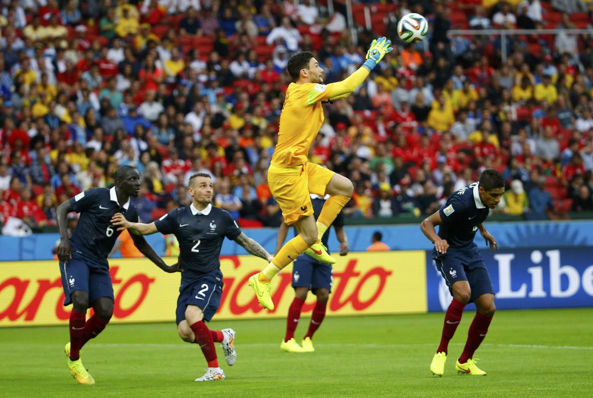 France's Lloris makes a save in front of his teammates during their 2014 World Cup Group E soccer match against Honduras at the Beira Rio stadium ...