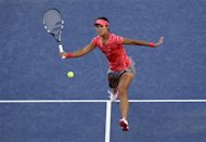 Li Na of China returns to Serena Williams of the U.S. at the U.S. Open tennis championships in New York September 6, 2013. REUTERS/Shannon Stapleton