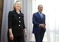 US Secretary of State Hillary Clinton (L) meets with Russian Foreign Minister Sergey Lavrov in St. Petersburg on the eve of international talks in Geneva to find a political solution to the Syrian crisis. Russia reported finding agreement with the United States on Syria and voiced optimism that crucial Geneva talks Saturday could bring a shift toward peace after 16 months of bloodshed