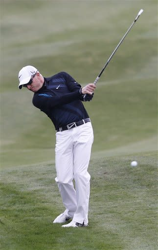 In this Oct. 25, 2013 photo, Simon Dyson hits a ball during the second round of the BMW Masters golf tournament at the Lake Malaren Golf Club in Shanghai, China. Dyson, in a six-way tie for second goi