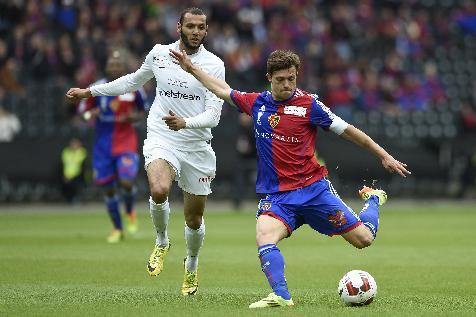 FCB's Valentin Stocker, right, fights for the ball with FCZ's Yassine Chikhaoui, left, during the Swiss Cup final soccer match between FC Basel and FC Zurich at the Stade de Suisse stadium in Bern, Switzerland, Monday, April 21, 2014