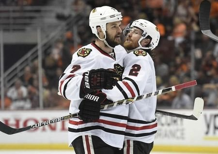 Chicago Blackhawks defenseman Brent Seabrook (7) celebrates with defenseman Duncan Keith (2) his goal scored against the Anaheim Ducks in game seven of the Western Conference Final of the 2015 Stanley Cup Playoffs at Honda Center; May 30, 2015; Anaheim, CA, USA; Gary A. Vasquez-USA TODAY Sports
