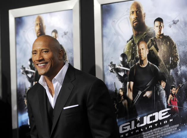 "Dwayne Johnson, a cast member in ""G.I. Joe: Retaliation,"" poses at the Los Angeles premiere of the film at the TCL Chinese Theatre on Thursday, March 28, 2013 in Los Angeles. (Photo by Chris Pizzello/"