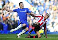 Chelsea midfielder Frank Lampard (left) vies with Brentford's Tom Adeyemi during the FA Cup fourth round replay match between Chelsea and Brentford in London on February 17, 2013. Chelsea eased into the fifth round with a 4-0 win