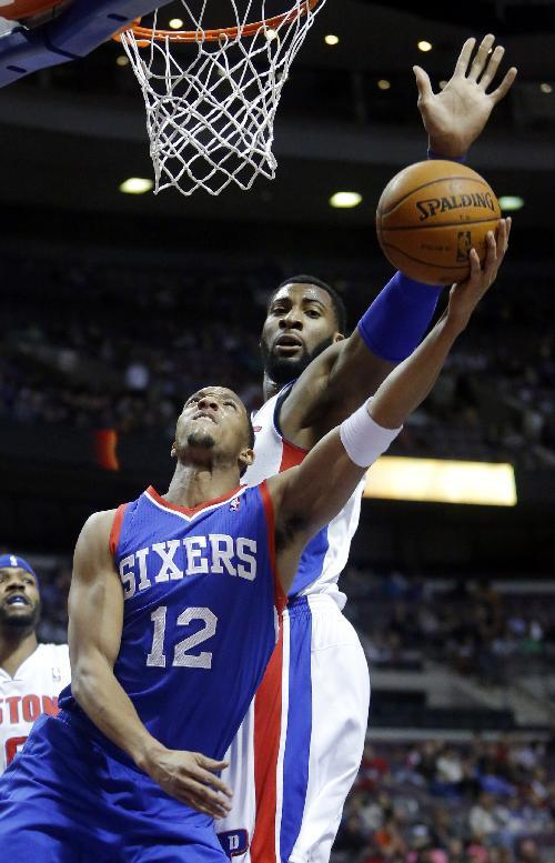 Detroit Pistons center Andre Drummond (0) defends against a shot by Philadelphia 76ers forward Evan Turner (12) during the first half of an NBA basketball game, Saturday, Feb. 1, 2014, in Auburn Hills, Mich. Drummond led all players with 22 points in a 113-96 win over the 76ers