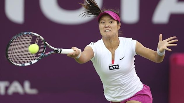 Li Na of China hits a return to Magdalena Rybarikova of Slovakia at the Qatar Open (Reuters)