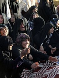 Iranians mourn over the covered bodies of loved ones in the village Baje-Baj, near the town of Varzaqan. Iran has stepped up relief operations in shattered villages in its northeast after saying rescue operations were completed following a double earthquake which cost 227 lives and injured 1,380 people