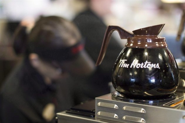 Freshly-brewed coffee sits on a hot plate in a Tim Hortons outlet in Oakville, Ont. on Sept.16, 2013. A refreshed vision for Tim Hortons begins to take shape this week as the company releases details on its financial results, and how it plans to remain innovative in the highly-competitive Canadian coffee market. THE CANADIAN PRESS/Chris Young