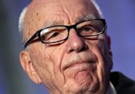 "A British parliamentary report says Rupert Murdoch, seen here in 2011, showed ""wilful blindness"" over phone hacking at his News of the World tabloid and was not fit to run a major company"