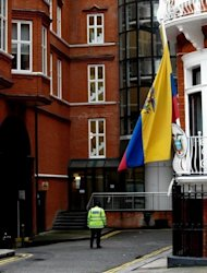 A police officer is seen patrolling outside the Ecuadorian embassy in London where the WikiLeaks founder Julian Assange is seeking refuge, on June 24. Assange refused to comply with a British police order to turn himself in for extradition to Sweden and instead walked into the Ecuadoran embassy on June 19, asking for asylum
