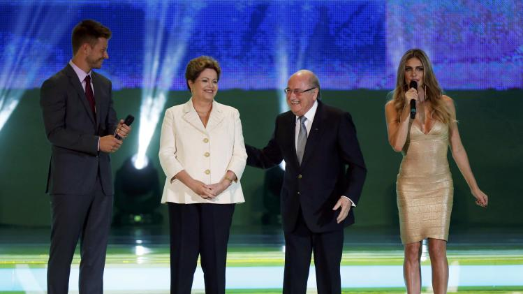 Brazilian President Rousseff, FIFA President Blatter, actor Hilbert and model Lima stand on stage during the draw for the 2014 World Cup at the Costa do Sauipe resort in Sao Joao da Mata