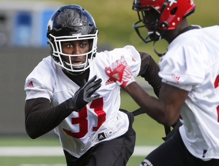 Calgary Stampeders' Osagie Odiase wears the No. 31 jersey of his fallen teammate and roommate Mylan Hicks in a team practice. (THE CANADIAN PRESS/Larry MacDougal photo)