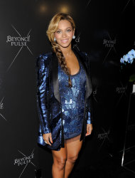 "Singer Beyonce unveils her new fragrance ""Pulse"" at the Dream Hotel on Wednesday, Sept. 21, 2011 in New York. (AP Photo/Evan Agostini)"
