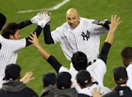 New York Yankees' Raul Ibanez celebrates with his teammatse after hitting a game-winning home run in the bottom of the twelfth inning to defeat the Baltimore Orioles 3-2 in a Major League Baseball playoff thriller