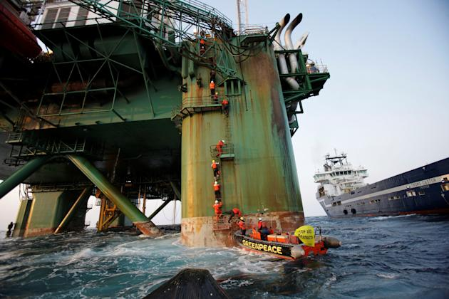 'GPAction' by Steve Morgan, snapped 180km off the coast of Greenland. A group of international Greenpeace activists climb onto the oil rig with the hope of stopping the drilling in Baffin Bay