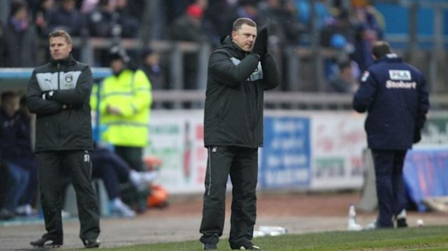 Mark Robins, centre, blasted Coventry's performance at Carlisle