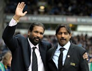 Blackburn Rovers owners Balaji Rao (L) and Venkatesh Rao (R), Directors of Venky's, take to the pitch at Ewood Park, Blackburn, on November 21, 2010. Blackburn global advisor Shebby Singh has rubbished claims that a Bollywood actor is a candidate to become the Championship club's manager