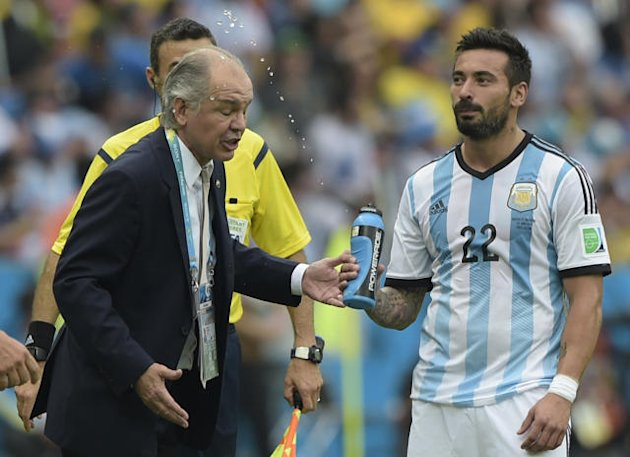 Watch hilarious footage as Argentina star squirts manager
