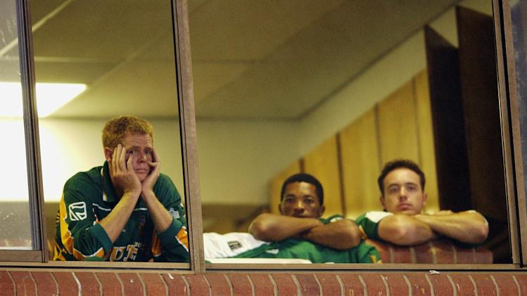 Shaun Pollock of South Africa holds his head in frustration as rain falls