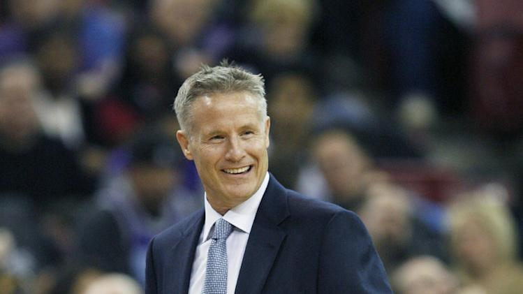 Philadelphia 76ers head coach Brett Brown smiles at his players  during the first half of an NBA basketball game in Sacramento, Calif., on Thursday, Jan. 2, 2014
