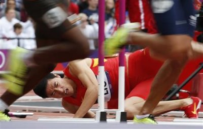 China's Liu Xiang falls after hitting a hurdle in his men's 110m hurdles heat. (Reuters)