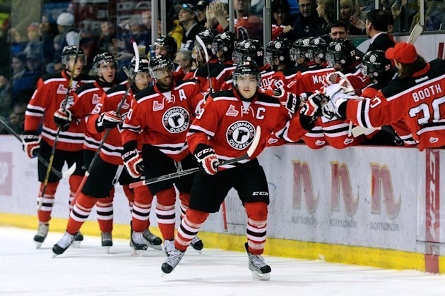 DRUMMONDVILLE, QC - FEBRUARY 23: Kurt Etchegary #19 of the Quebec Remparts celebrates his game tying goal with teammates during the QMJHL game against the Drummondville Voltigeurs at the Centre Marcel Dionne on February 23, 2014 in Drummondville, Quebec, Canada. The Remparts defeated the Voltigeurs 3-2 in a shootout. (Photo by Richard Wolowicz/Getty Images)