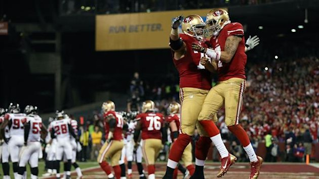 San Francisco 49ers quarterback Colin Kaepernick (7) celebrates with guard Alex Boone (75) after a touchdown against the Atlanta Falcons (Reuters)