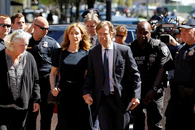 Actress Felicity Huffman arrives at the federal courthouse with her husband William H. Macy, before being sentenced in connection with a nationwide college admissions cheating scheme in Boston, Massachusetts, U.S., September 13, 2019. REUTERS/Katherine Taylor