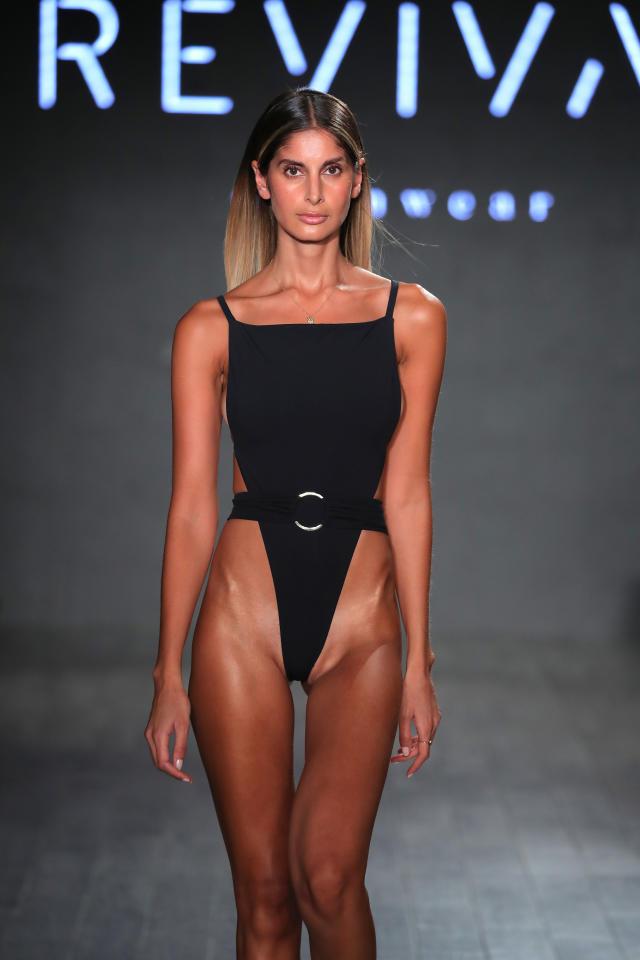 A model walks the runway during Revival Swimwear Runway Show