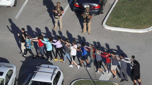 PHOTO: People are brought out of the Marjory Stoneman Douglas High School after a shooting at the school on Feb. 14, 2018 in Parkland, Fla. (Joe Raedle/Getty Images)
