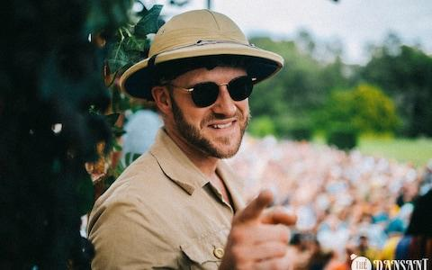 A reveller in colonial-style pith helmet at the controversial party - Credit: Jelle Dreesen