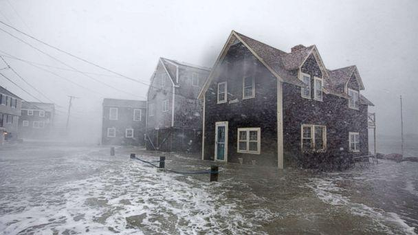 PHOTO: Lighthouse Rd. begins to flood during a large coastal storm March 2, 2018 in Scituate, Mass. (Scott Eisen/Getty Images)