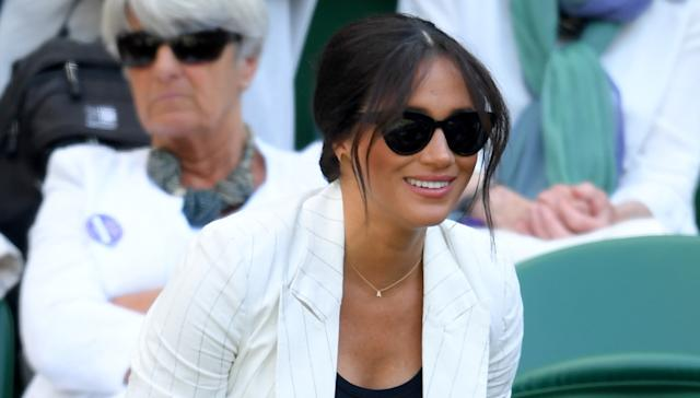 Meghan wore a new necklace with an 'A' for Archie at Wimbledon. [Photo: Getty]