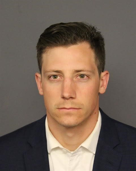 This photo provided by the Denver Police Department shows Chase Bishop. Bishop turned himself in to the Denver Sheriff's Department Tuesday, June 12, 2018, and is being held for Investigation of 2nd Degree Assault. Police have said Bishop was dancing at a downtown club on June 2 when the gun fell from the agent's waistband holster onto the floor. The firearm went off when the agent picked it up. (Denver Police Department via AP)
