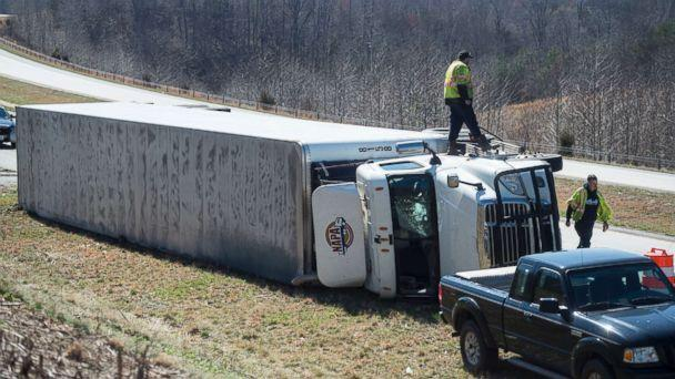 PHOTO: Fuel is siphoned from an overturned tractor-trailer on northbound 29 in Amhesrt, Va., March 2, 2018. Virginia's coast is bracing for possible flooding in the wake of the nor'easter that slammed into the East Coast. (Jay Westcott/The News & Advance via AP)