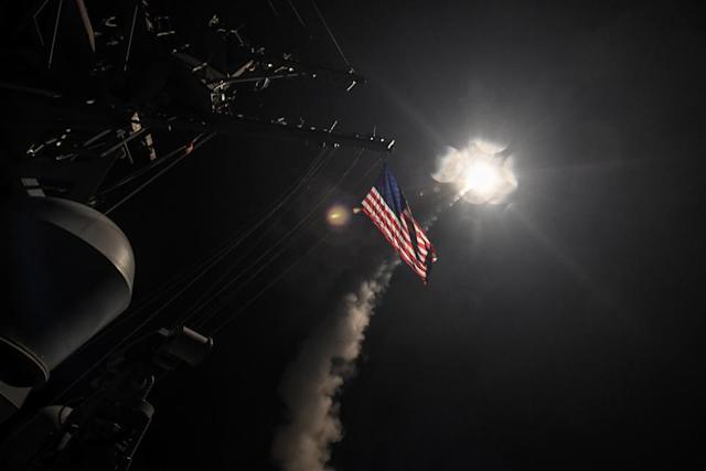 U.S. Navy guided-missile destroyer USS Porter conducts strike operations from the Mediterranean Sea against Al-Shayrat air base in Homs, Syria, April 7, 2017. Russia disputed the claim that it was informed ahead of time and has threatened to destroy U.S. warships if they again endangered the lives of Russian personnel in Syria. Ford Williams/U.S. Navy/Reuters