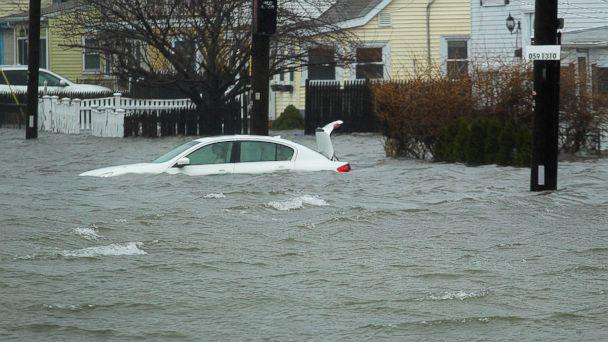 A car along Sea Street, is under several feet of water during the storm, Friday, March 2, 2018 in Quincy, Mass. (AP)