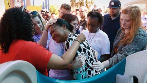 PHOTO: People comfort each other at a prayer vigil for the victims of the shooting at Marjory Stoneman Douglas High School at the Parkland Baptist Church, Feb. 15, 2018. (Wilfredo Lee/AP)