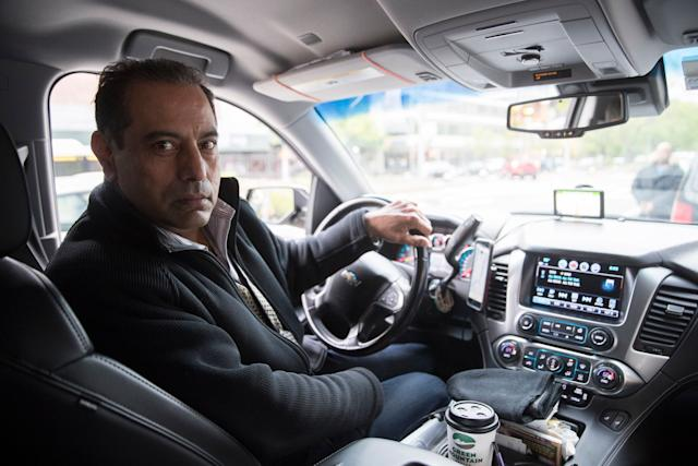 This Friday, May 3, 2019 photo shows Uber driver and NYTWA member Inder Parmar in his vehicle in New York.